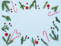 Free Christmas Card - Fir Tree Branches, Red Cranberries, Xmas Gifts And Candy Canes On Pastel Blue Background Stock Photo - 200058790