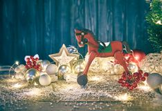 Christmas card with firtree balls and red wooden horse white snow copyspace. Stock photo Royalty Free Stock Photography