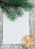 Christmas card with firtree branch Royalty Free Stock Photos