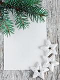 Christmas card with firtree branch Royalty Free Stock Image