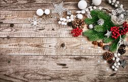 Christmas card with firtree pinecone and glass balls on old wooden board in rustic style copyspace. Stock photo Stock Photos
