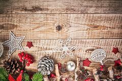 Christmas card with firtree pinecone and glass balls on old wooden board in rustic style copyspace. Stock photo Royalty Free Stock Photography