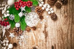 Christmas card with firtree pinecone and glass balls on old wooden board in rustic style copyspace. Stock photo Stock Photography