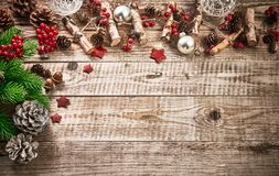 Christmas card with firtree pinecone and glass balls on old wooden board in rustic style copyspace. Stock photo Stock Images