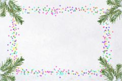 Christmas card flat lay with fir branches and copy space in frame of colored confetti on natural snow background. vector illustration