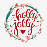 Christmas card with floral wreath and lettering Stock Photos