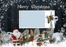Christmas card with frame, Santa Claus, pine branches and Christmas decorations Stock Image