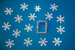 Christmas card with frame and snowflakes on a blue background Royalty Free Stock Photos