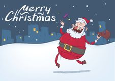 Christmas card with funny smiling Santa Claus. Santa brings gifts and throws candies on snowy night city background Royalty Free Stock Photo