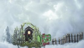 Christmas card gate,door .tree,mail box in cloud day. Christmas card gate,fiance ,tree ,mail box ,door in cloud day stock images