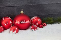 Christmas card with german Frohe Weihnachten Merry Christmas t. Ext and decoration Stock Images
