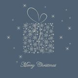 Christmas card with gift. On blue background Royalty Free Stock Image
