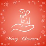 Christmas card with gift box. Card with gift box on hand and greetings Royalty Free Stock Images