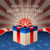 Christmas card with gift box in the colors of the US flag on a retro background. Christmas and New Year background with some space for text Royalty Free Stock Photography