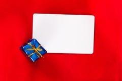 Christmas Card with Gift Box Stock Image