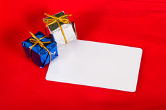 Christmas Card with Gift Box Stock Photos