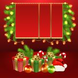Christmas card, gift boxes, ball, candy, garland. Christmas card with gift boxes with gold ribbon bow, garland, Christmas tree balls, Santa cap, candy sticks and Royalty Free Stock Image
