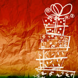 Christmas card with gift boxes on wrinkled paper Royalty Free Stock Photo