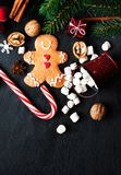 Christmas Card with Christmas gift, Gingerman cookie, fir tree b Stock Images