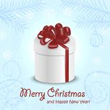 Christmas card with a gift in the middle on blue background. Vector illustrations Stock Photos