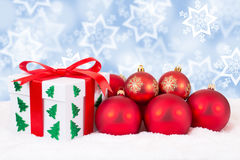 Christmas card gift winter snow decoration gifts and red balls Stock Photography