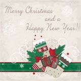 Christmas card with gifts and stockings Royalty Free Stock Images