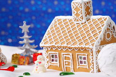 Christmas card with gingerbread house and tree Royalty Free Stock Photography