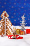 Christmas card with gingerbread house and tree Royalty Free Stock Image