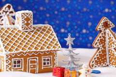 Christmas card with gingerbread house and tree Royalty Free Stock Photos