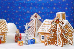 Christmas card with gingerbread house and tree Royalty Free Stock Images
