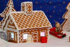Christmas card with gingerbread house and tree Stock Images