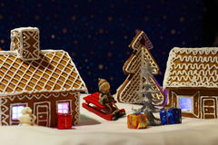Christmas card with gingerbread house and tree Stock Photos