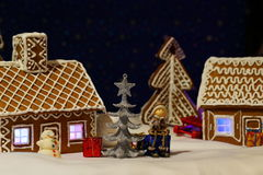 Christmas card with gingerbread house and tree Stock Photo