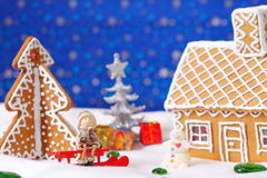 Christmas card with gingerbread house and tree Stock Photography