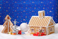 Christmas card with gingerbread house and tree Stock Image