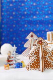 Christmas card with gingerbread house and tree Royalty Free Stock Photo