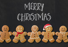 A christmas card with gingerbread men Royalty Free Stock Image