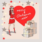 A christmas card from a girl. A christmas card of a christmas girl. Presents stars and a girl in a red dress. Big red heart shape in the background Royalty Free Stock Photos