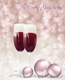 Christmas card with glasses of wine. On a snowy background Royalty Free Stock Photos