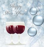 Christmas card with glasses of wine. On a snowy background Stock Images