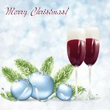 Christmas card with glasses of wine. On a snowy background with a spruce branch Stock Images