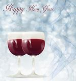 Christmas card with glasses of wine. On a snowy background Stock Photos