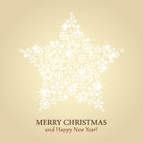 Christmas card  - gold background with sparkling star Stock Photo