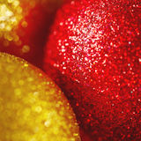 Christmas card with gold baubles and sparkles Royalty Free Stock Photo