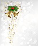 Christmas card with gold bells and holly Stock Photography