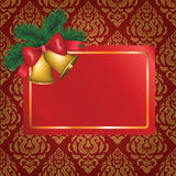 Christmas card with gold bells and tree branch Stock Image