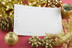 Christmas card and gold bows Stock Photography