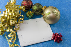 Christmas card gold curly ribbon Royalty Free Stock Image
