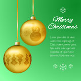 Christmas card with gold pendants in the shape of a ball. Decorate fir, snowflakes, snowman. Classical green background  space for Stock Photos
