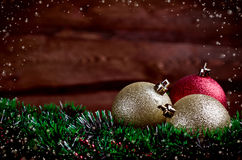 Christmas card with a gold and red toys Stock Images